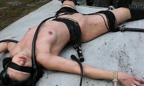 Roped and lashed in the dirt